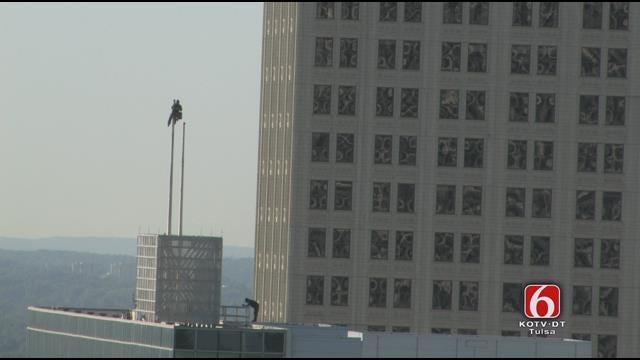 WEB EXTRA: Worker Fixes City Hall Flag Pole