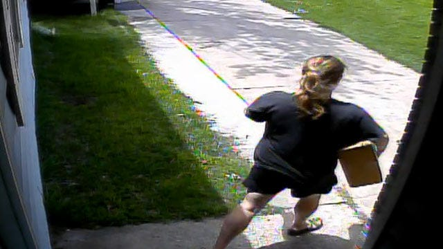 WEB EXTRA: Surveillance Video Showing Woman Taking Package Off Porch
