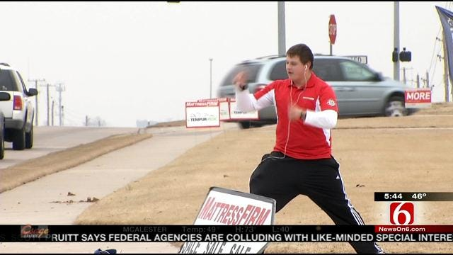 South Tulsa Sign Drummer Attracts Crowds