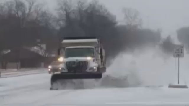 WEB EXTRA: City Plow Throws Snow On Car