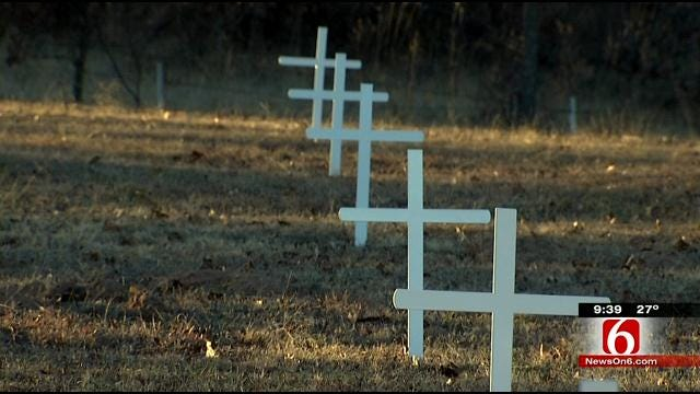 Bristow Boy Scout Renews Crosses At Poor Farm Cemetery