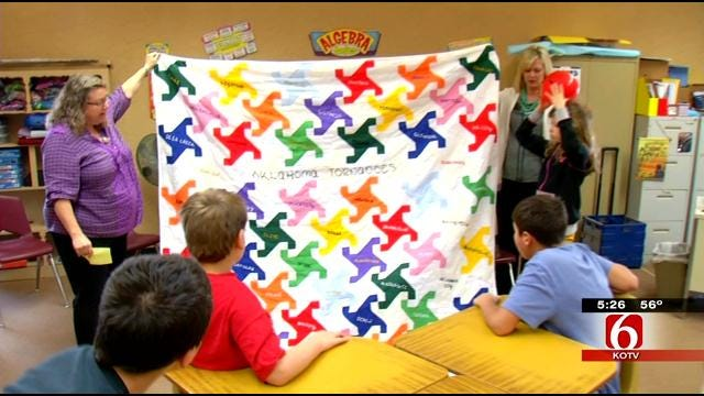 Beggs Middle School Students Present Quilt To News On 6 Meteorologist Dick Faurot