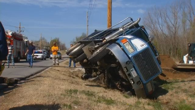 WEB EXTRA: Storey Wrecker Gets Overturned Dump Truck Right Side Up