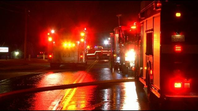 Sand Springs Firefighters Battle Strong Winds, House Fire