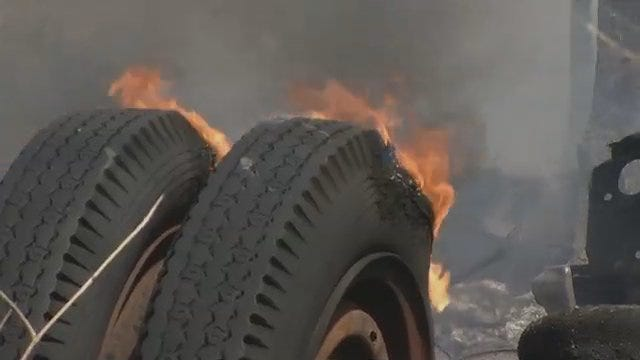 Tires Burn At Sperry Salvage Yard