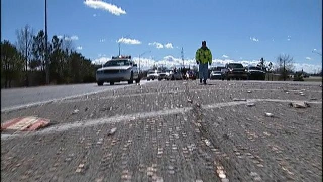 WEB EXTRA: Thousands Of Pennies Spilled On The Highway
