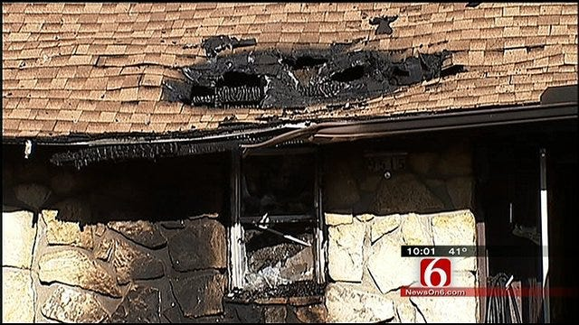 Tulsa Police Officers Rescue Homeowners From House Fire