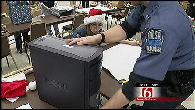 Tulsa Police Officers Deliver Early Christmas Gifts To Area Families
