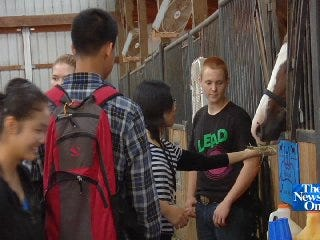 Jenks FFA Hosts Chinese Exchange Students in Day at the Farm