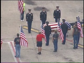 SKYNEWS 6: Soldier's Casket Unloaded From Airplane By Military Honor Guard