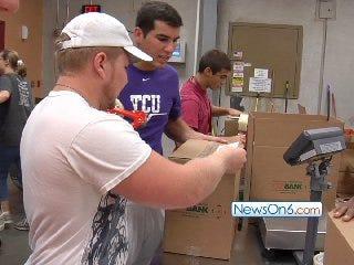 Members of Booker T. Washington Football Team Assist at Food Bank