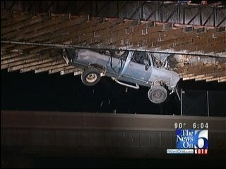 Truck Left Dangling Off Bridge After Tulsa Driver Ignores Barricades