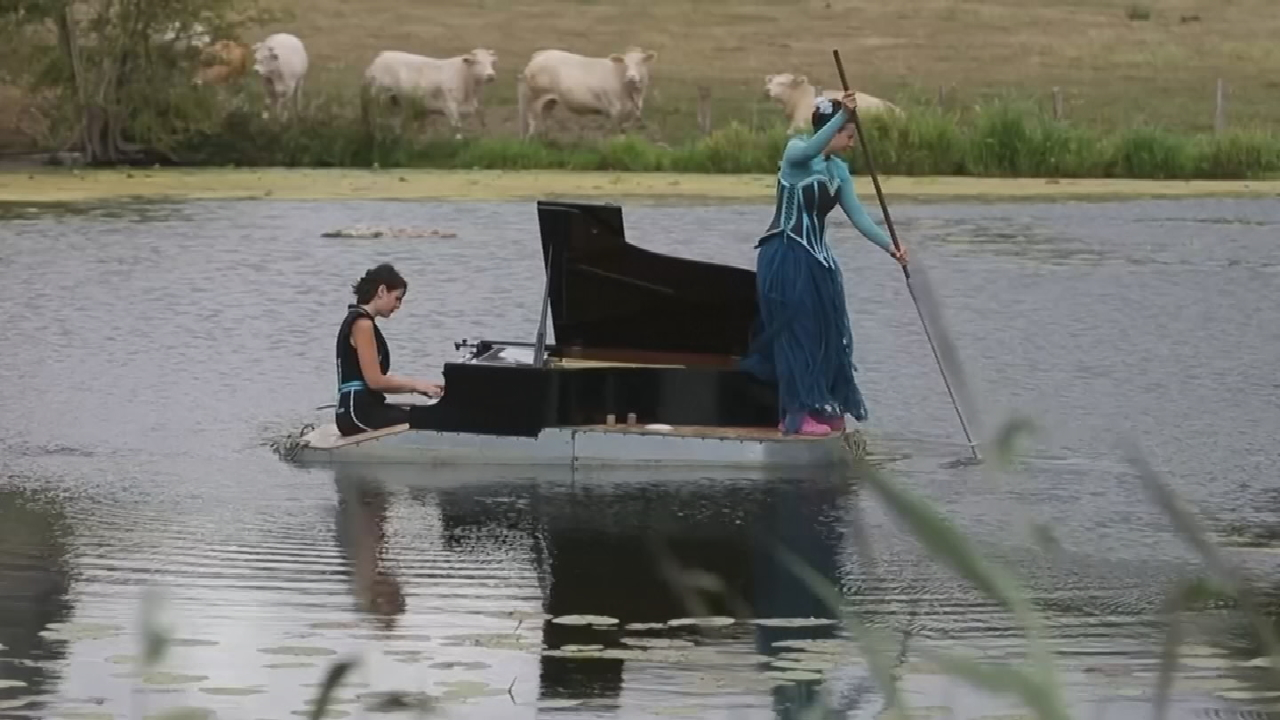 Musician Performs On Floating Piano In The French Countryside