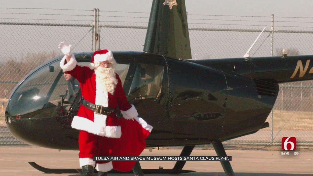 Santa Surprises Kids At Tulsa Air And Space Museum