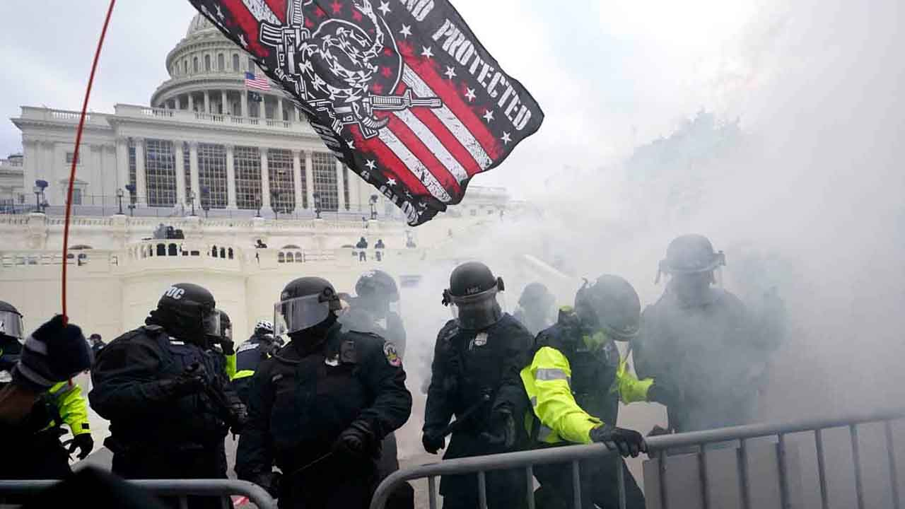 Black Officer Seen Risking His Life To Lead Capitol Mob Away From Senate Chamber Hailed As Hero