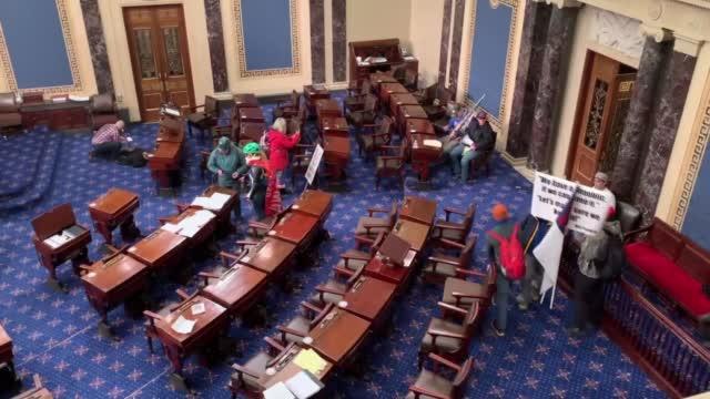 Watch: Rioters Wave Flags Inside U.S. Senate Chamber