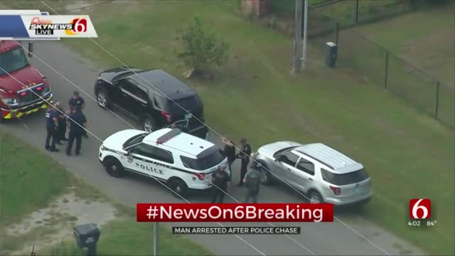 Police Arrest Man After Pursuit, Pushing Woman Out Of Car