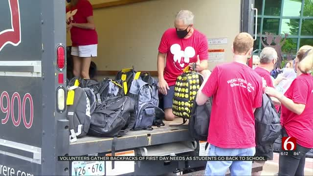 Volunteers Gather Backpacks Of First Day Needs As Students Return To School