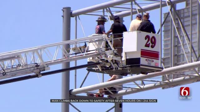 Officials 'Relieved' After Man Climbs Down After Nearly 7 Hours On I-244 Sign