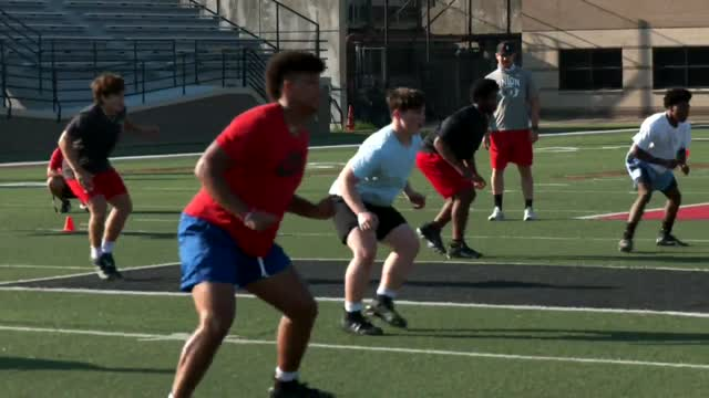 Union Football Team Builds In Offseason As New Stadium Is Built Beside Them