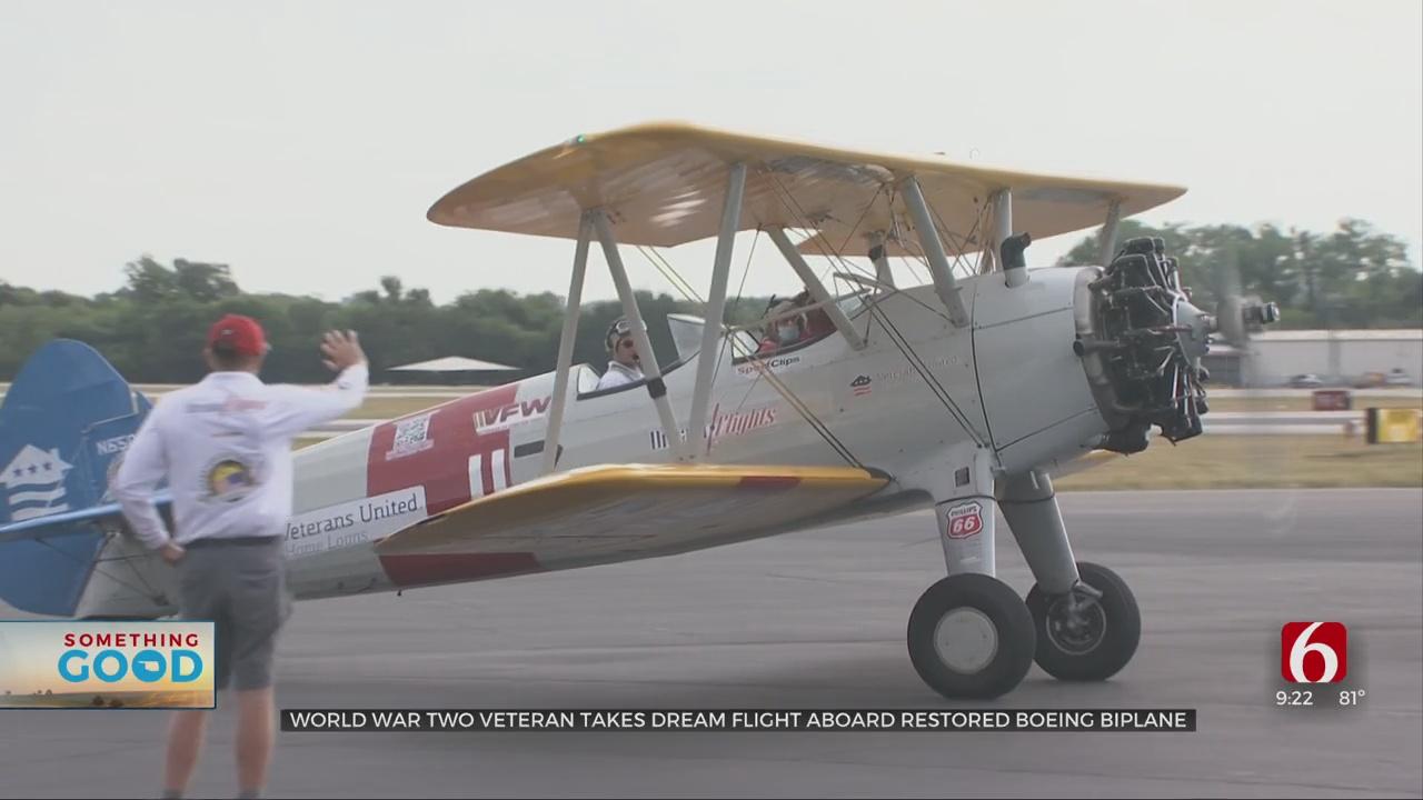 World War II Veteran Takes Dream Flight Aboard Restored Boeing Biplane