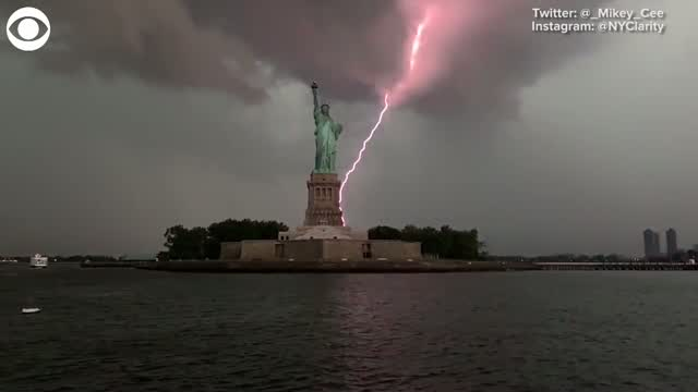 WOW: Lightning strikes Close To The Statue of Liberty