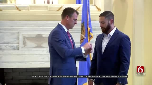 Gov. Stitt Awards State Of Oklahoma Purple Heart To 2 Tulsa Police Officers