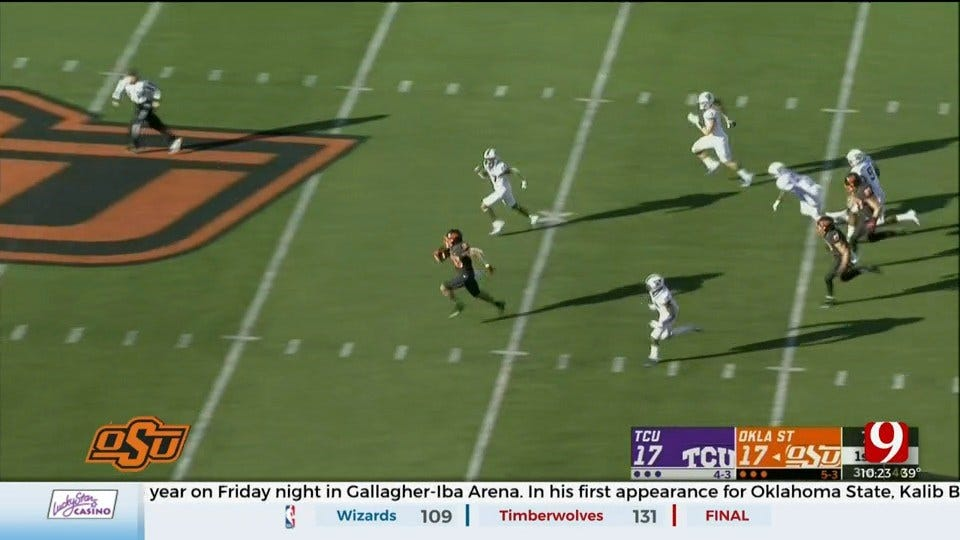 Hubbard's 223 Yards, 2 TDs Lead Oklahoma St Past TCU 34-27