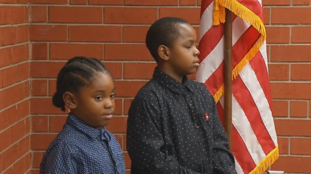 Boys Recite Pledge Of Allegiance Next To Flag Outside Fire Department