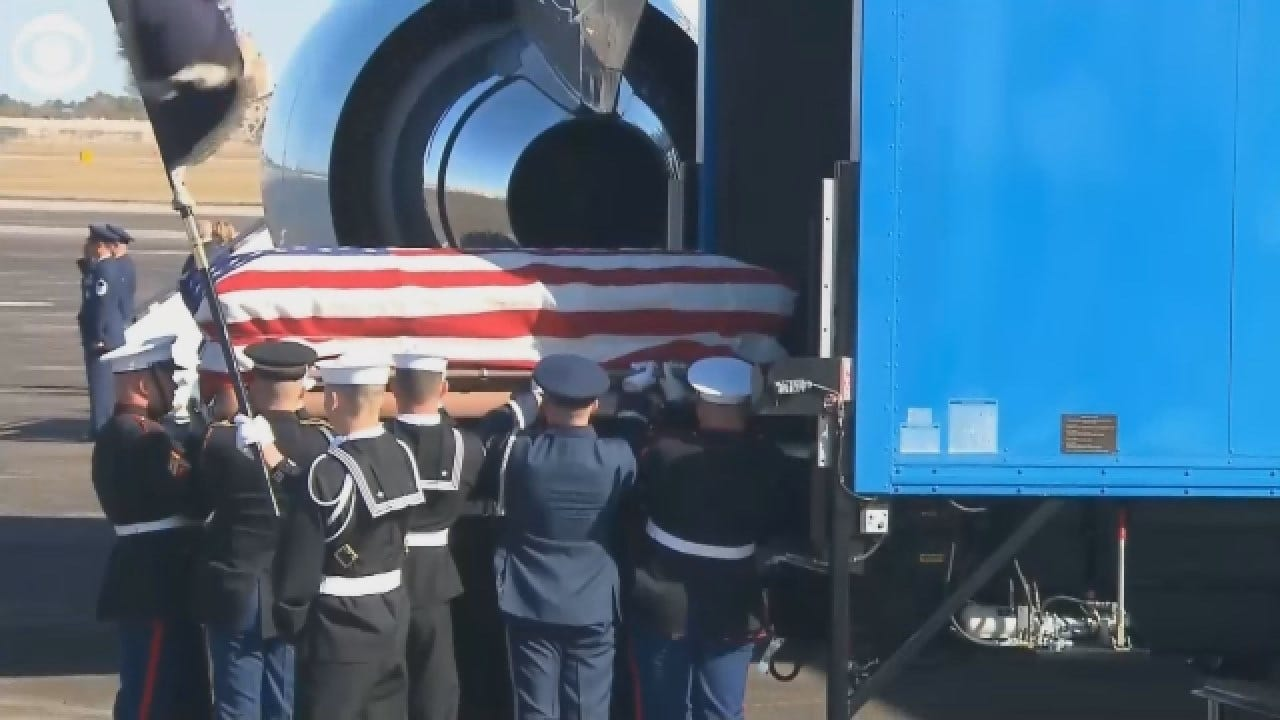 HW Bush's Casket Arrives At Ellington AFB To Be Flow To Washington