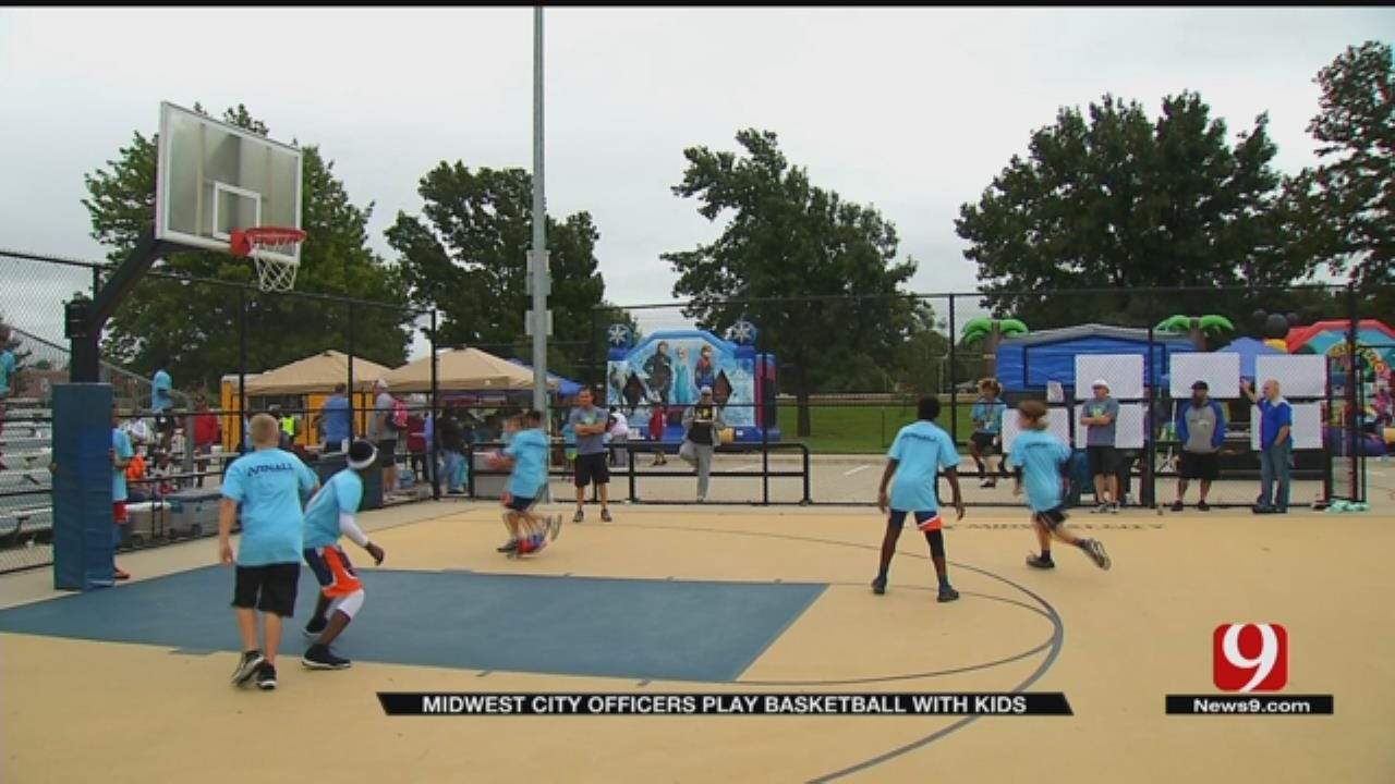 MWC Police Bond With Kids During Basketball Tourney