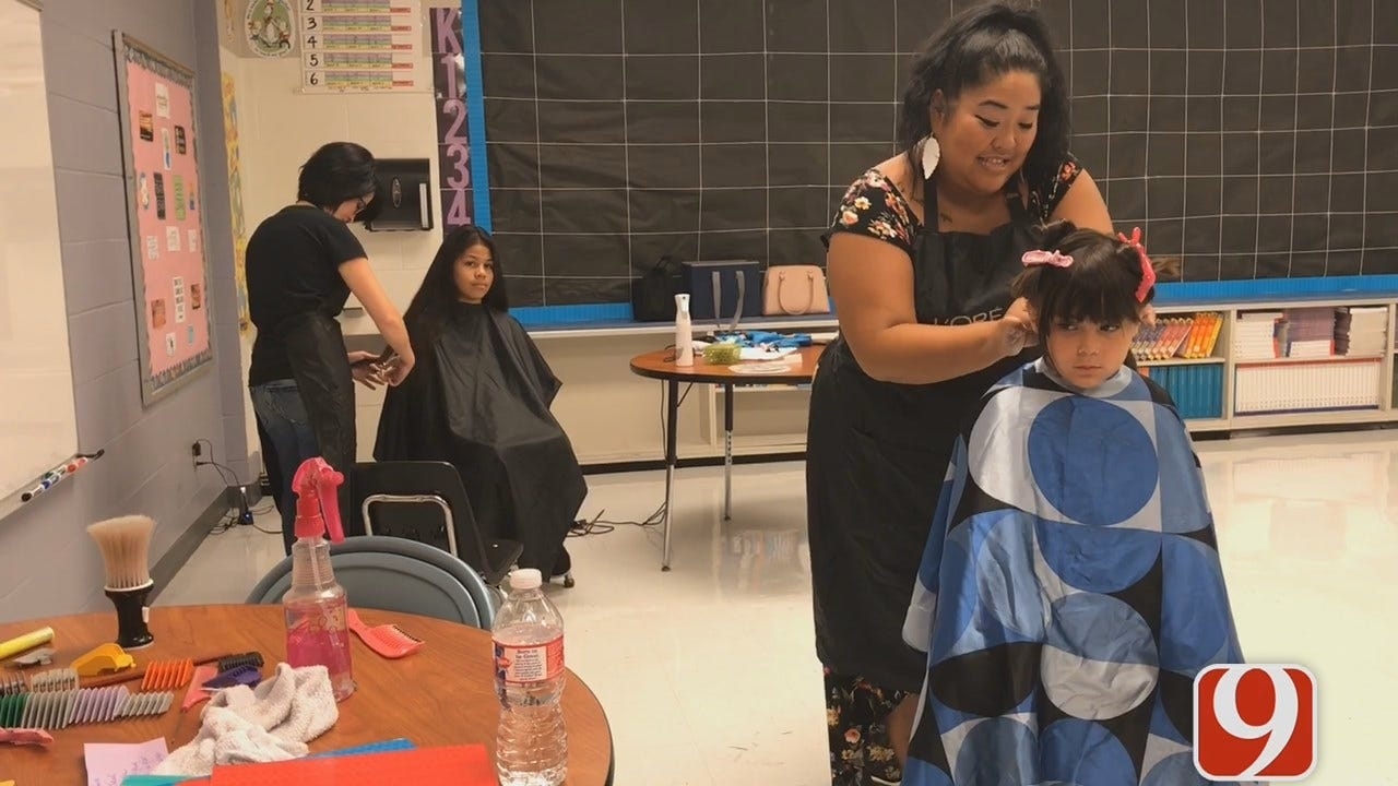 WEB EXTRA: Teachers Cut Students' Hair For Back To School