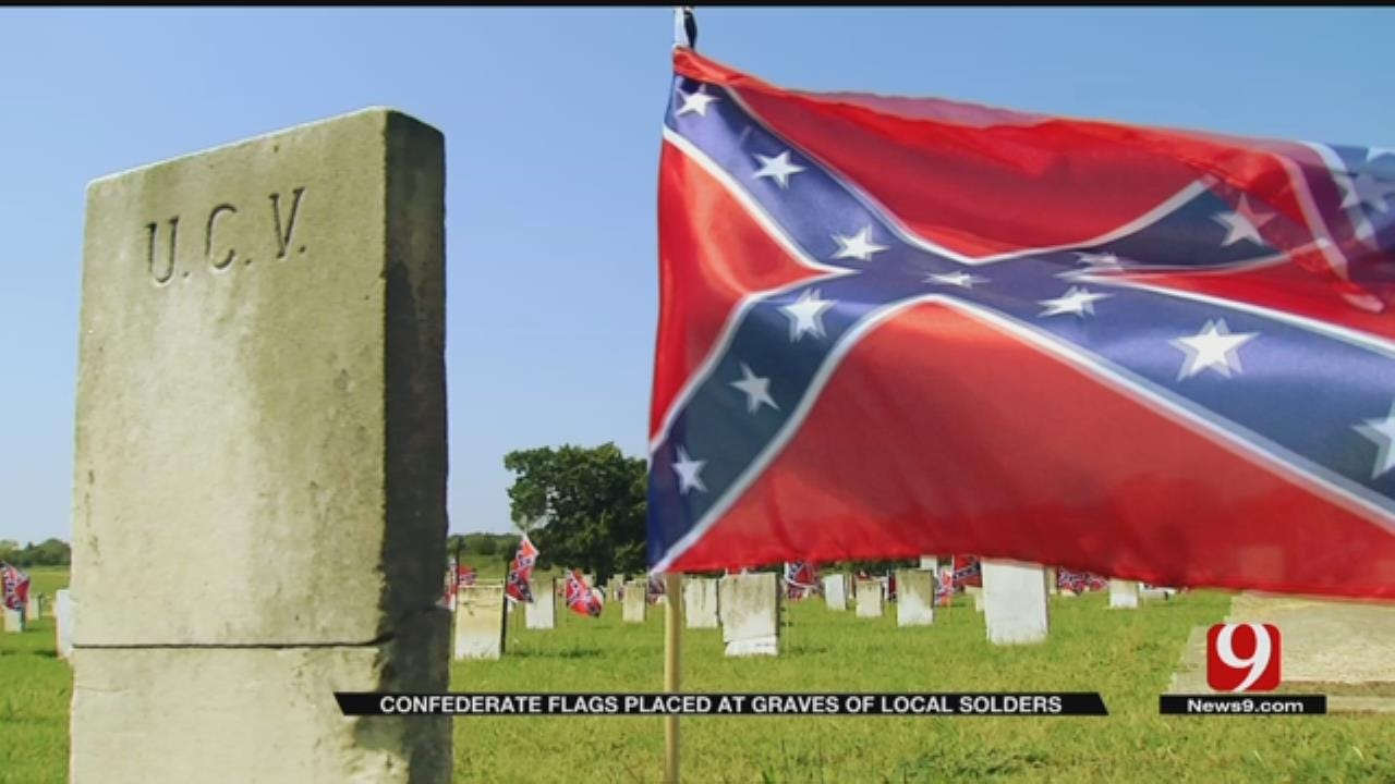 Woman Planting Confederate Flags At Ardmore Cemetery
