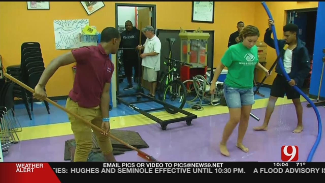 Volunteers Clean Up Flooded Nonprofit