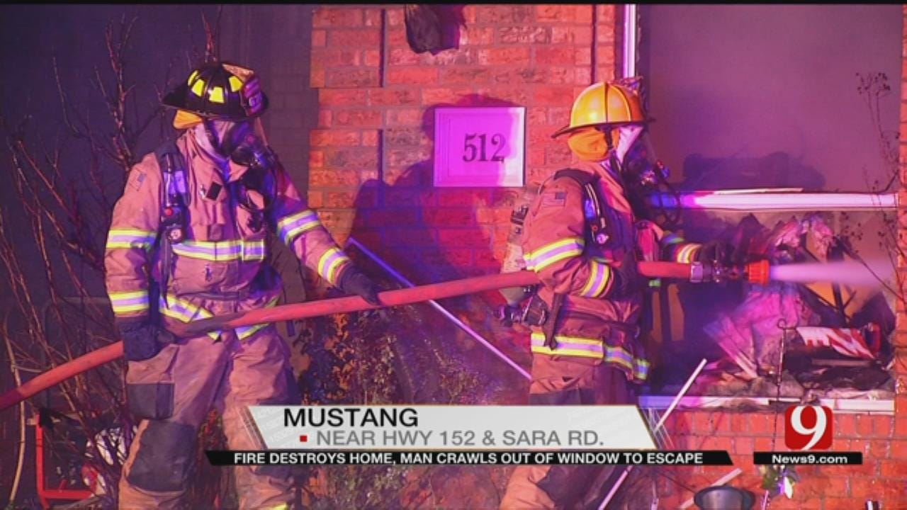 Man Crawls Out Of Window To Escape Mustang House Fire