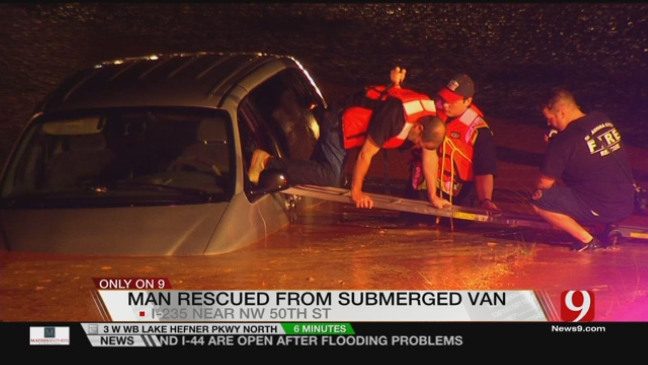 Driver Rescued From Flood