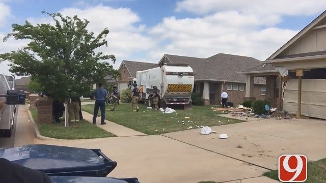 Crews looking For Answers To Why Trash Truck Crashed Into Home