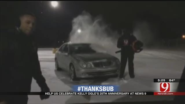 Kelly Clears Snow Off Cars At News 9