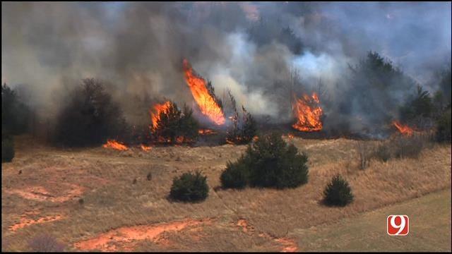 WEB EXTRA: Bob Mills SkyNews 9 HD Flies Over Luther Grass Fire
