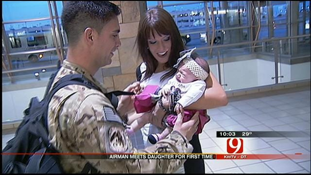 Airman Returns Home To Wife, New Baby In OKC For Christmas