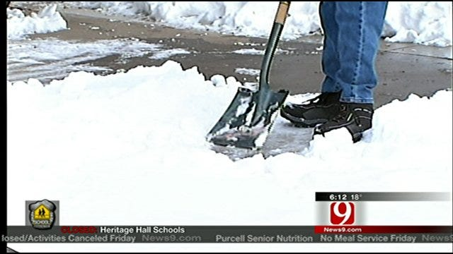 People Lending A Hand To Help Clear Snow