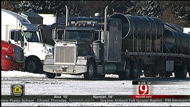 Drivers Easing Along Slick, Slushy Roads