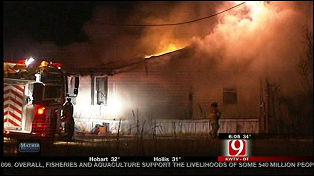 Firefighters Battle Slaughterville House Fire