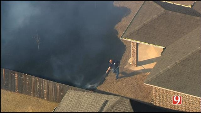 WEB EXTRA: Man Helps Stop Fire From Burning Neighbor's NW OKC Home