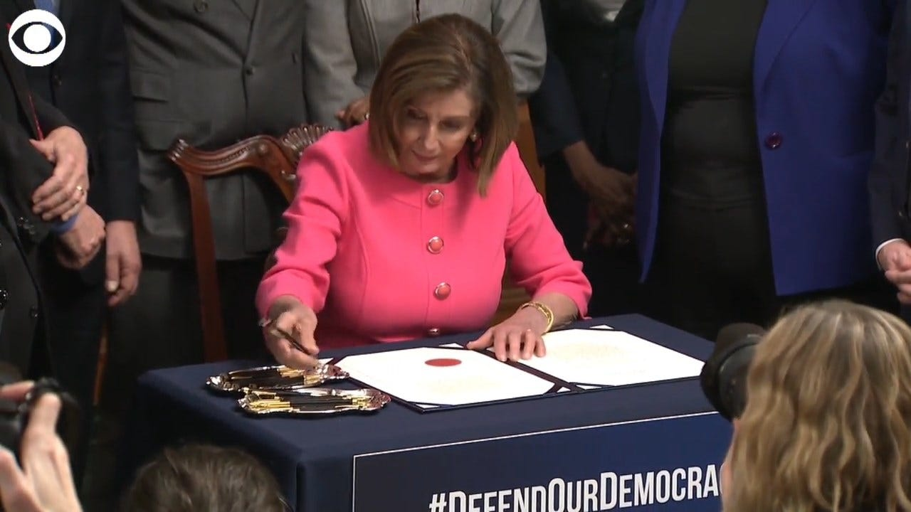 Nancy Pelosi Signs Impeachment Articles Against President Trump
