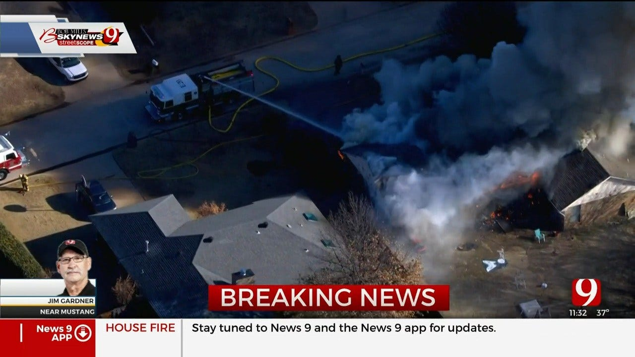 Firefighters Battle Large House Fire In Mustang