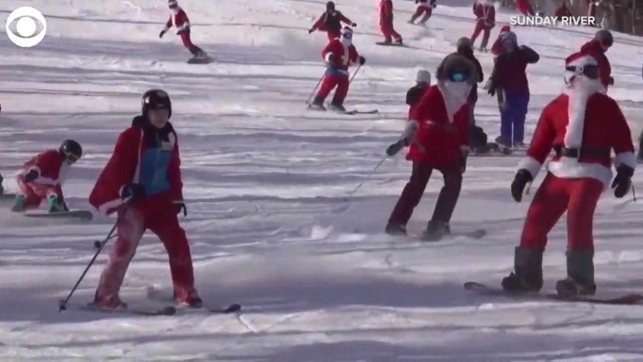 WATCH: 200 Santas Hit The Ski Slopes