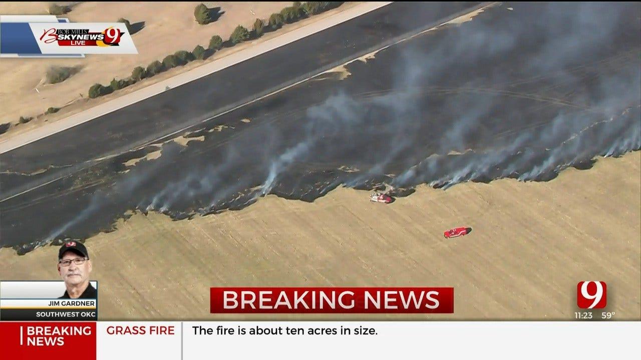 Firefighters Battle Grass Fire Near Will Rogers World Airport