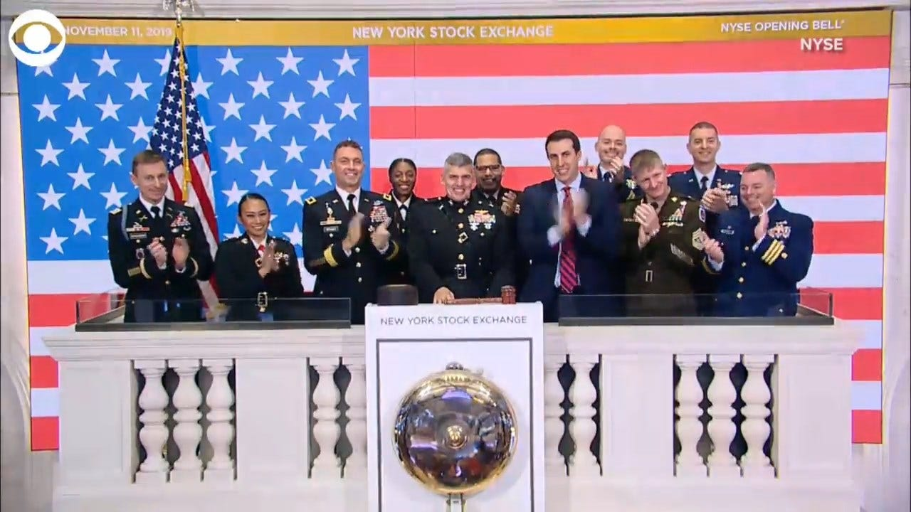 NYSE Holds Moment Of Silence, Members Of Armed Forces Ring Opening Bell For Veterans Day