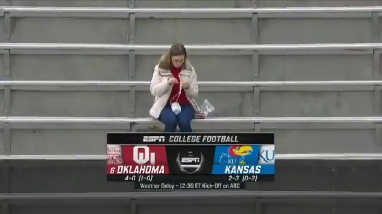 WATCH: 'Crochet Lady' Sitting Alone At OU, Kansas Football Game Going Viral